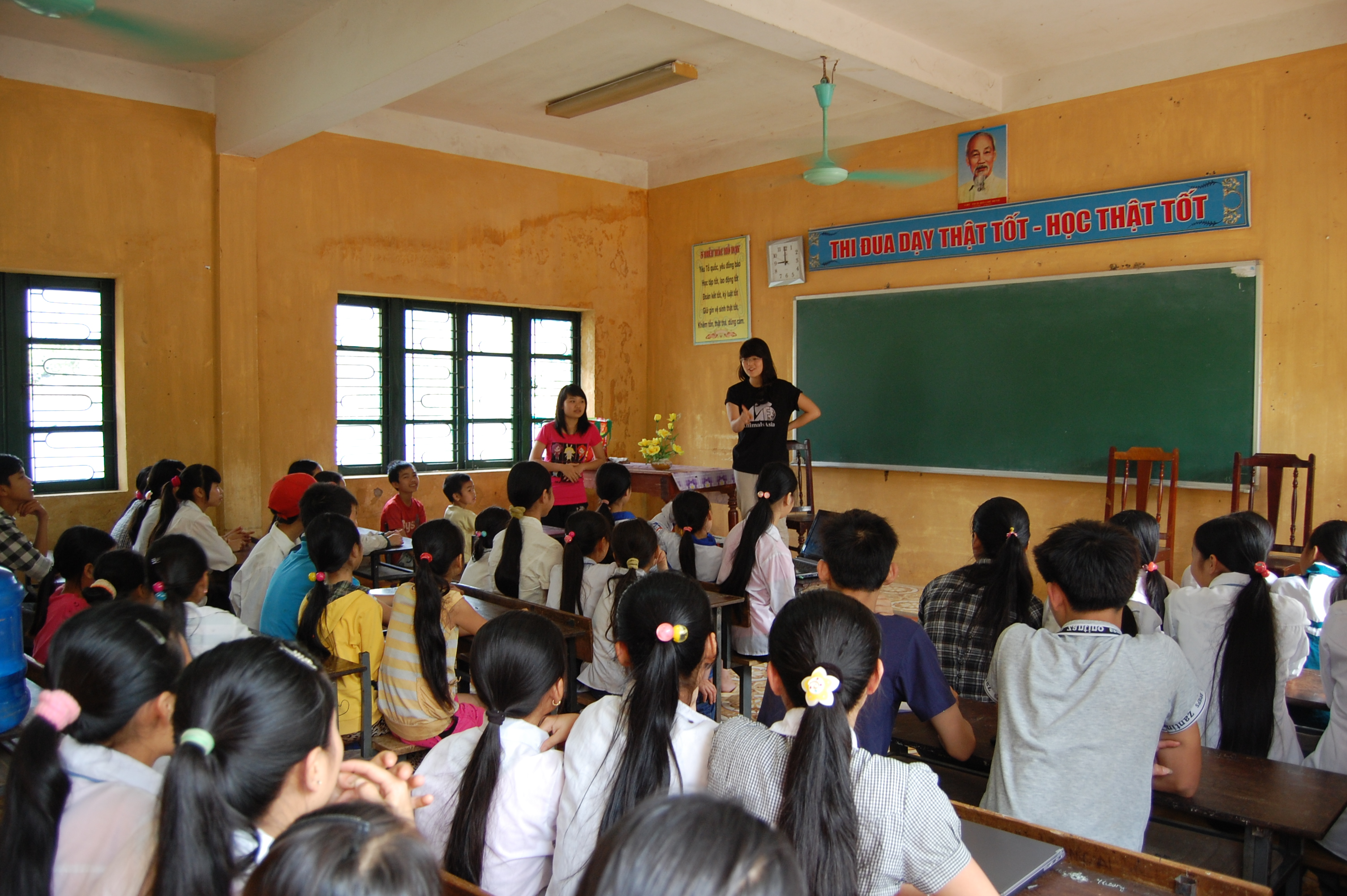 The university students teaching about health and nutrition to local children.