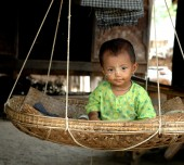 Volunteer Myanmar child in basket
