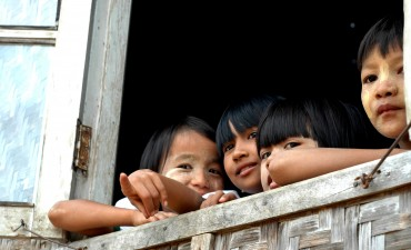Volunteer Myanmar children looking out of window