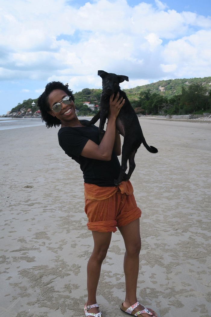 volunteer with dog on beach resize