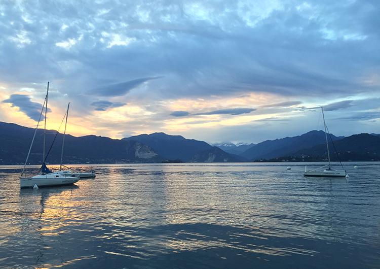 sailboats-on-a-lake-at-sunset