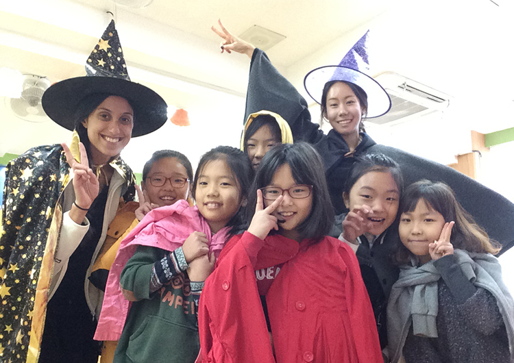 Teachers and students wearing Halloween costumes in Korea.