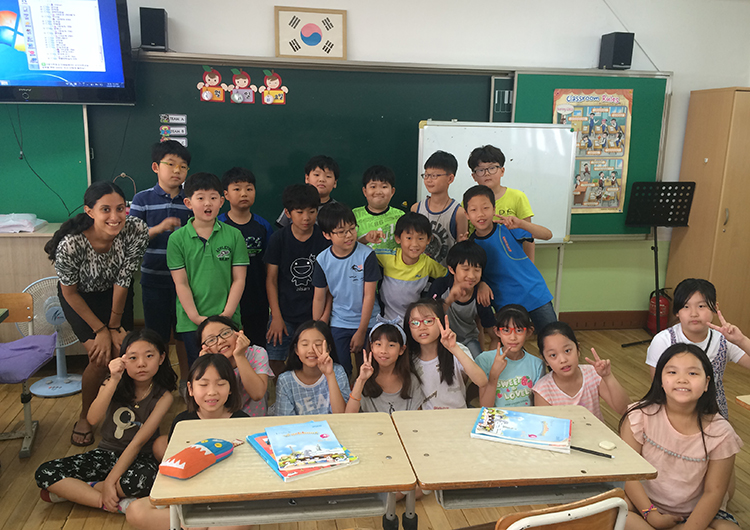 An English teacher in the classroom with students in South Korea.