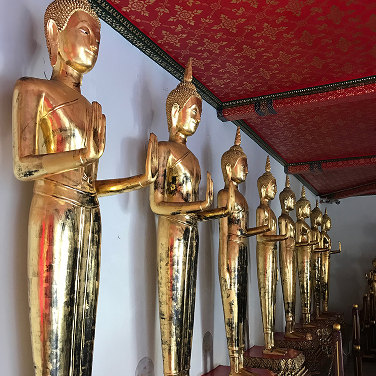 Beautiful golden statues of Buddha in Thailand.
