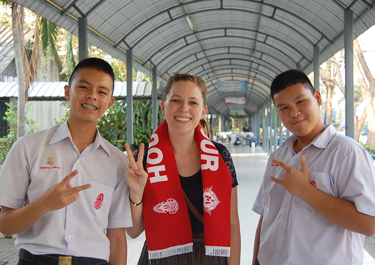 An English teacher with students in Thailand.