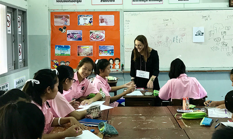 An English teacher in a classroom of Thai students.