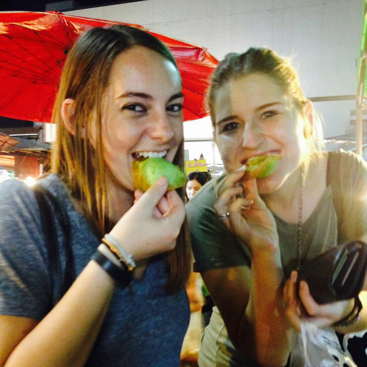 Eating a green pastry in Thailand.