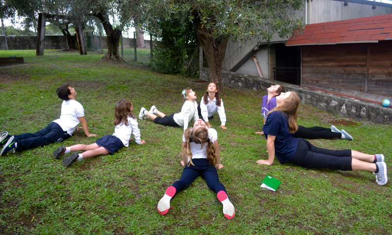 A circle of students doing a stretching activity.
