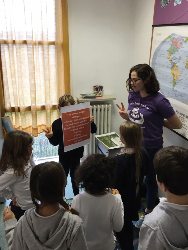 Kids doing a pledge in a classroom.