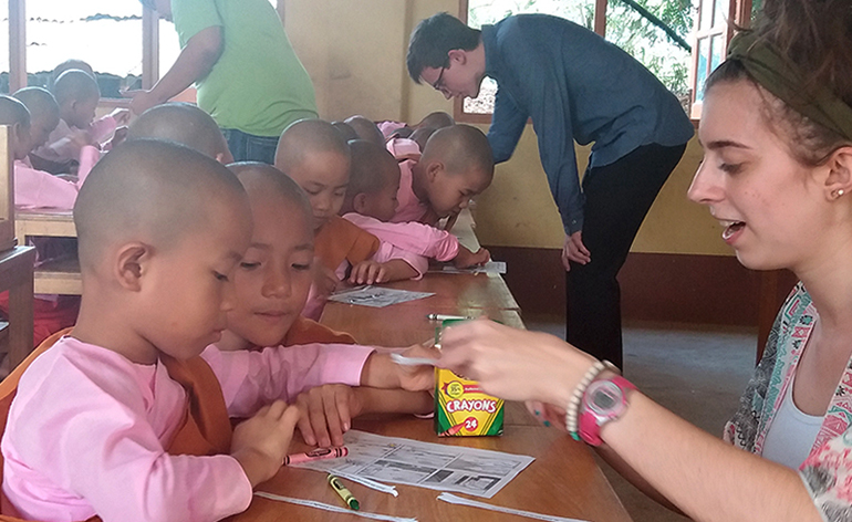 A teacher with nuns at an orphanage in Myanmar.