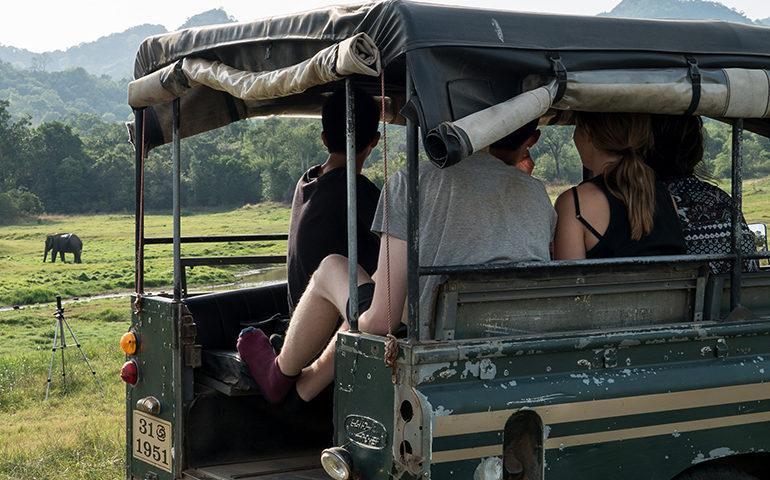 Volunteers in the back of a truck in Sri Lanka.