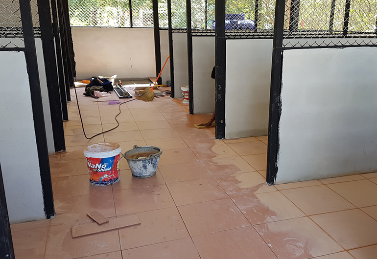 New tile floor inside a dog kennel in Thailand.