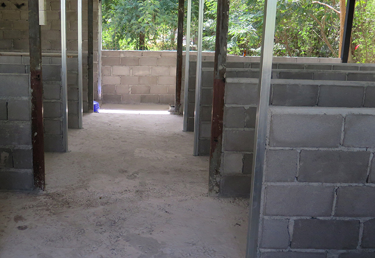 The new cement floor of a kennel in Thailand.