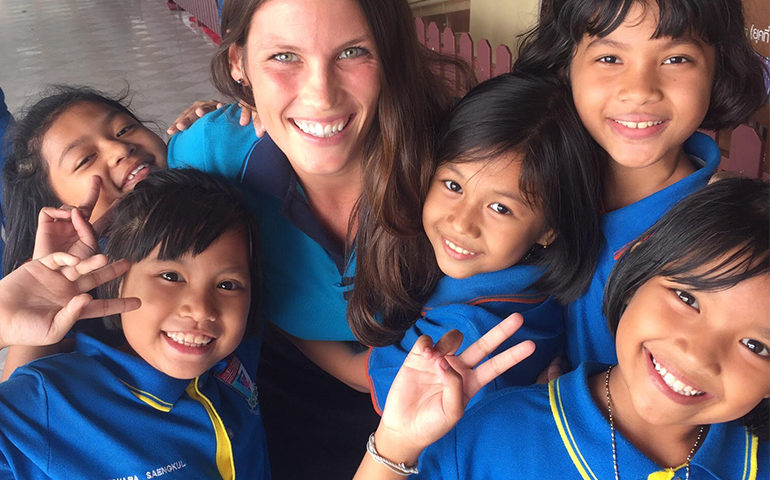 A teacher with kids in Thailand.