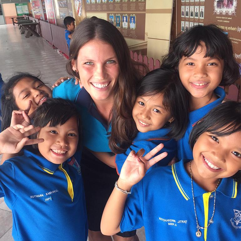 A teacher with kids in Thailand.