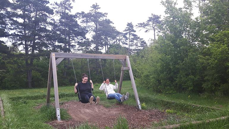 Two women swinging in Austria.