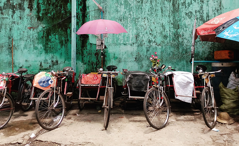 Trishaws lined up in Yangon, Myanmar.