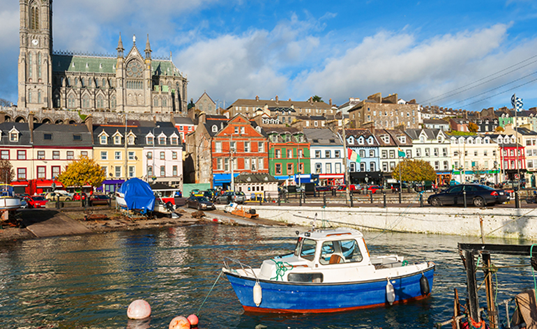 A colorful boat and buildings at the harbor in Cork, Ireland.