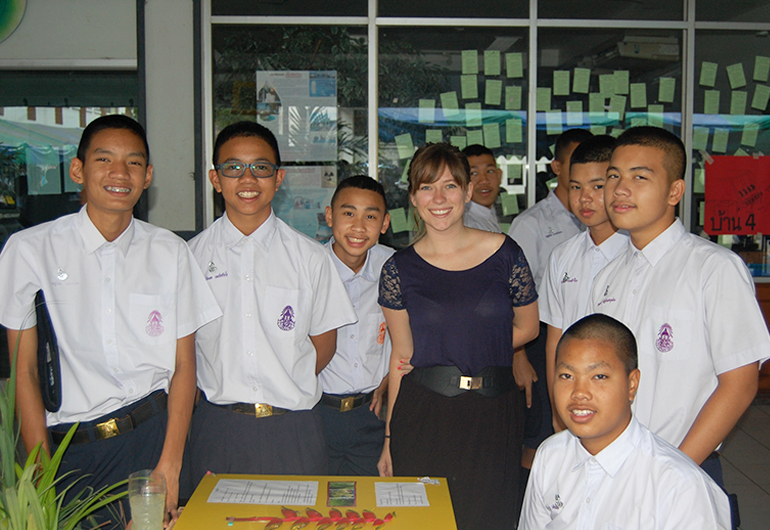 A foreign English teacher with students in Thailand.