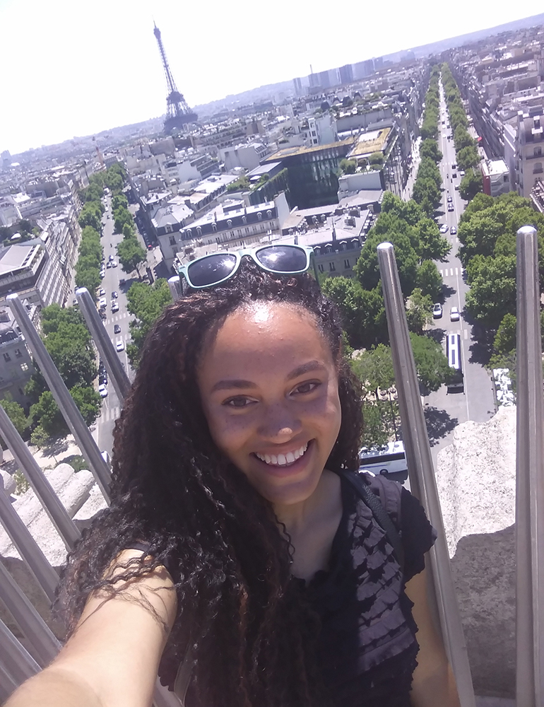 Angelique with the Eiffel Tower in the distance.