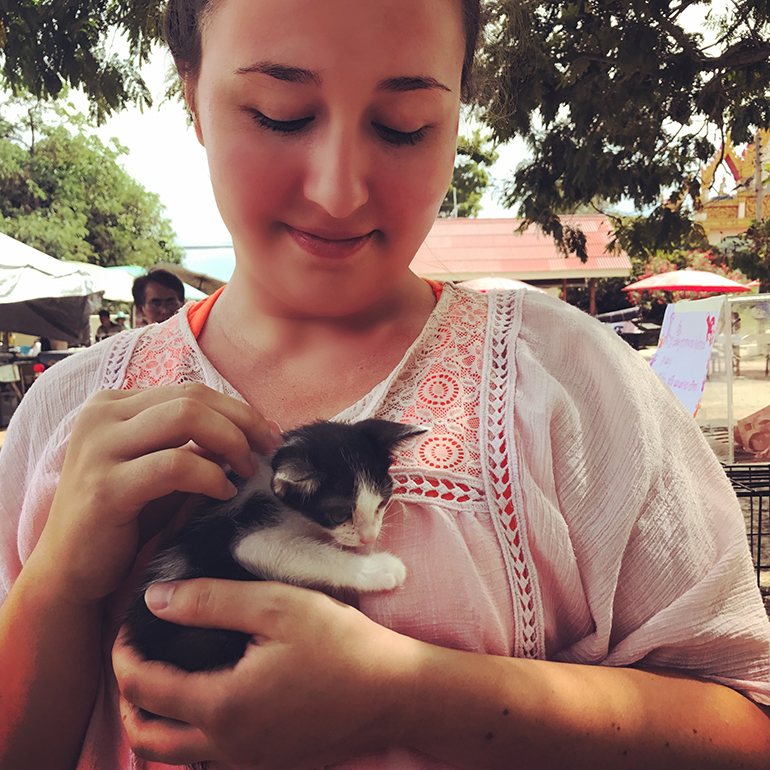 A volunteer holding a kitten in Thailand.