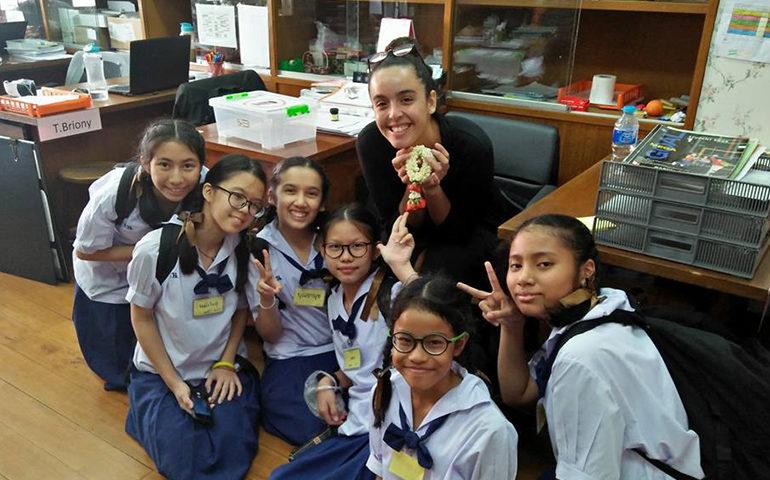 Greenheart Traveler, Carolina Azcuna, with students in Thailand.