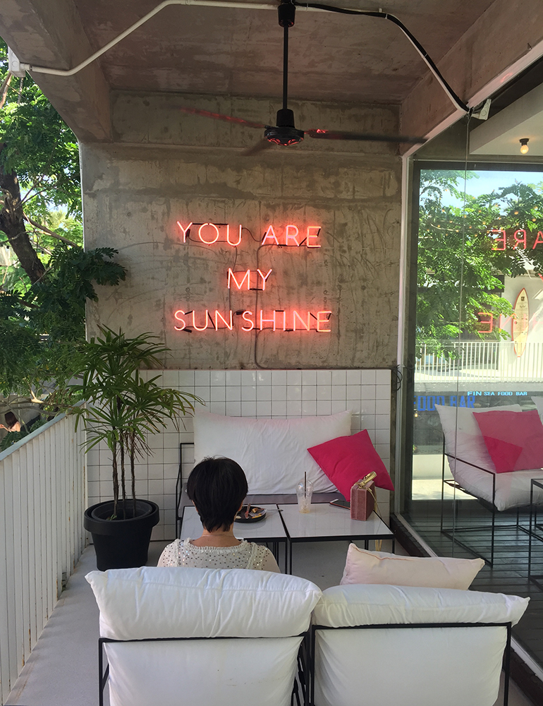 A neon sign inside a cafe in Thailand.