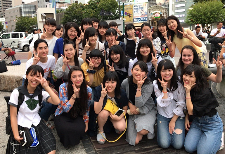 Greenheart Traveler, Maggie, with new friends in Japan.