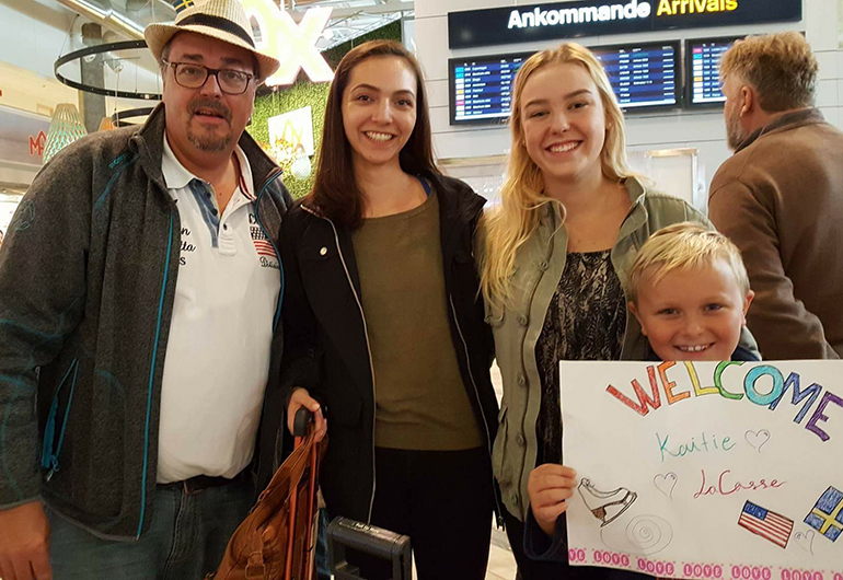 A Greenheart Traveler getting picked up at the airport by her host family.