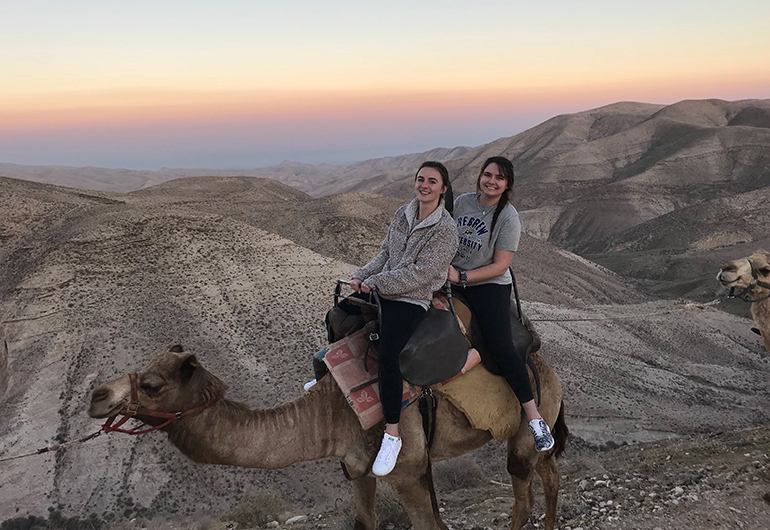 Girls on a camel in Israel
