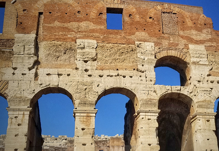 Rome's Colosseum on a bright, sunny day. Photo by Greenheart Traveler Susan LacCanne.