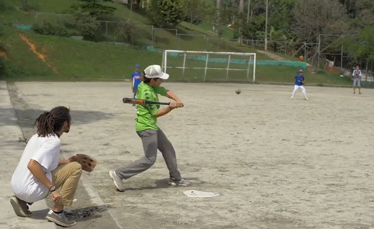 Greenheart Traveler, Mac Hightower, playing baseball with youth in Colombia.