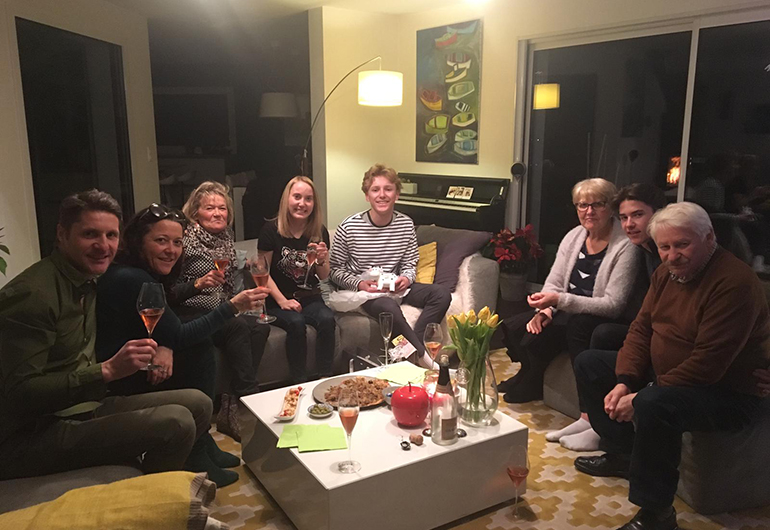 Ian and his host family in France enjoying a meal and wine together.