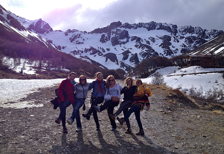 Students posing in front of the snowcapped mountains in Argentina.