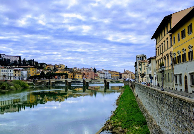 The Arno River in Florence, Italy on a cloudy day.