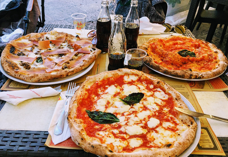Three delicious pizzas from Naples, Italy.