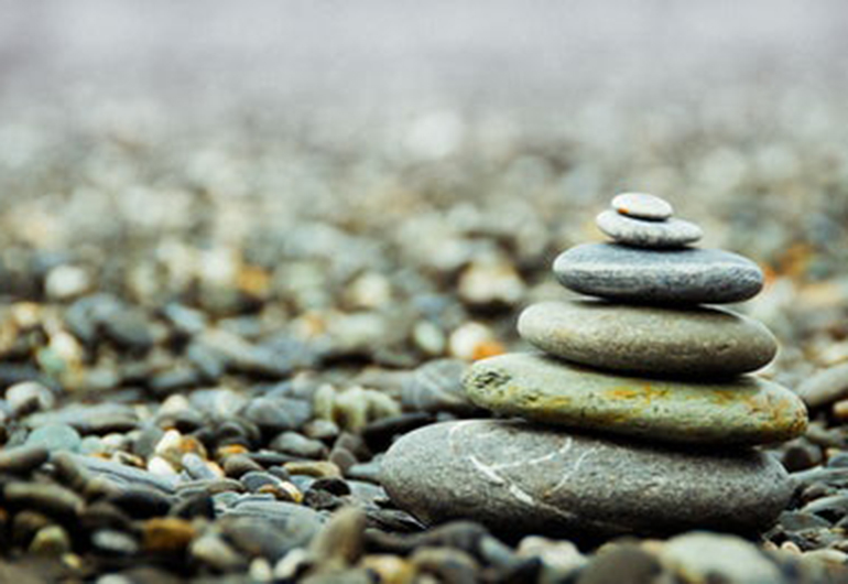 This rock cairn represents many things from a trail marker to an aesthetic depiction of balance and peace.