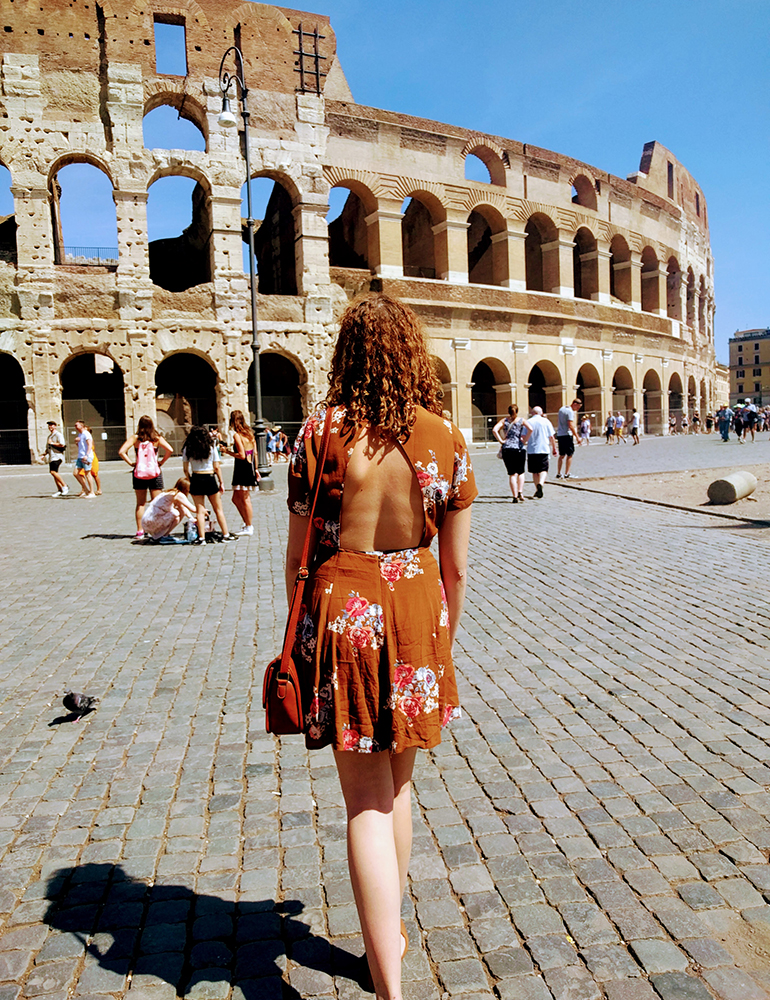 Mikaela walking towards the Colosseum in Rome, Italy.